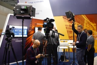 camera-crew is setting up camera for interview at MWC2019 in Barcelona