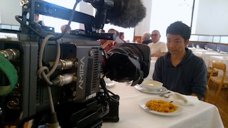 setting up ARRI AMIRA camera for filming a table scene in CSIC restaurant Madrid