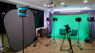 green-screen interview filming set with camera and lighting in Barcelona