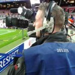 bilingual cameraman at Champions League match Spain