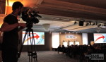 cameraman filming management conference in Barcelona