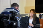 bilingual cameraman filming corporate interview Barcelona